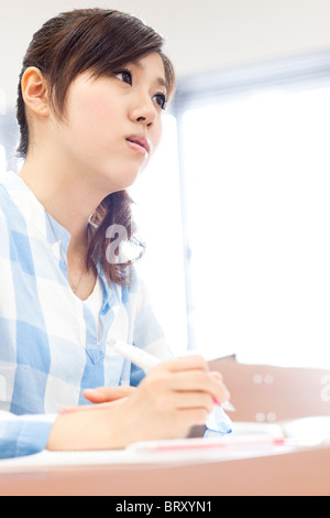 Young woman studying in classroom Japan - Stock Photo