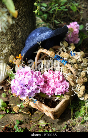 Freshly picked flowers in a wicker basket Oxfordshire UK - Stock Photo