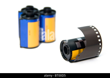 Isolated 35mm film roll with blurred rolls in the background - Stock Photo