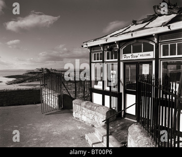 The entrance to the derelict Birnbeck Pier. The pier and Birnbeck Island in the distance. Weston-super-Mare, Somerset, - Stock Photo