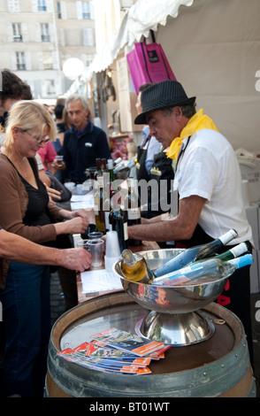 People tasting wine at the 'Fête des vendanges', grape harvest festival, Montmartre, Paris - Stock Photo