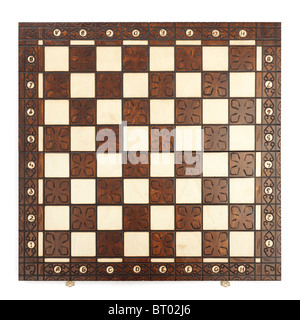 Wooden chess board isolated on white background - Stock Photo