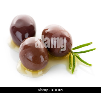 Kalamata olives in olive oil and herbs - Stock Photo