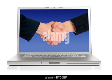 A modern silver computer on a white background, Handshaking on the screen - Stock Photo