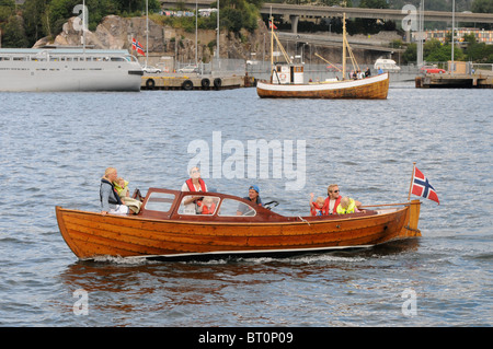 Family out in boat for the departure of the Tall Ships from Kristainsand Norway - Stock Photo