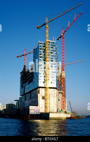Hochtief construction site of the future Elbphilharmonie (concert hall) on top of Kaispeicher A at Hafencity in - Stock Photo