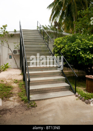 Tsunami steps on a indian ocean tropical island - Stock Photo
