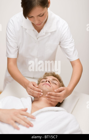 Male cosmetics - facial massage at luxury spa - Stock Photo