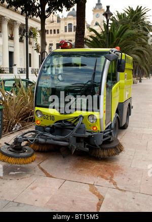 Malaga municipal electric road sweeper Spain - Stock Photo