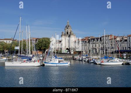 La Rochelle Old Port Harbor marina with Porte de la Grosse Horloge ( Big Clock Gate) in the background, Charente - Stock Photo