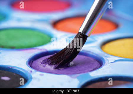 Artist's watercolor palette with brush - Stock Photo