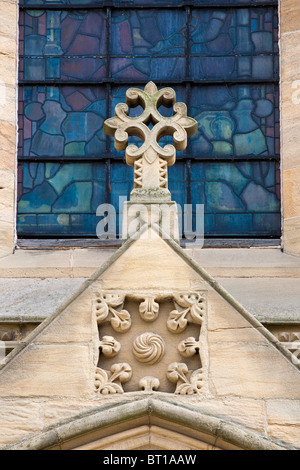 Stone cross above front door to Ripon Cathedral, North Yorkshire, England, UK, GB. - Stock Photo