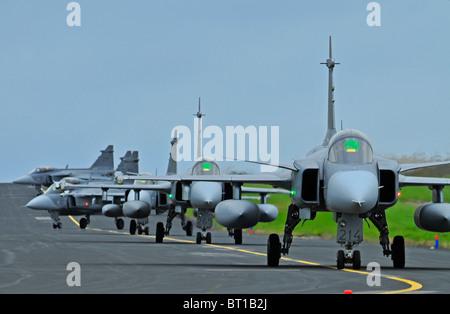 Saab JAS 39 Gripens single engined fast military Swedish jet fighter aircraft.  SCO 6850 - Stock Photo
