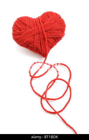 Yarn of wool in heart shape symbol - Stock Photo