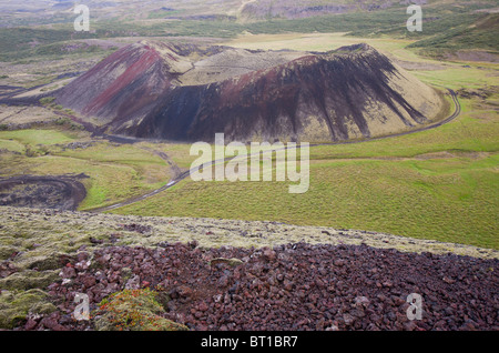 Grabrokarfell volcanic crater caused by a fissure eruption in Western Iceland near Reykholt - Stock Photo