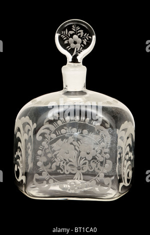 Vintage etched glass scent / perfume bottle - Stock Photo