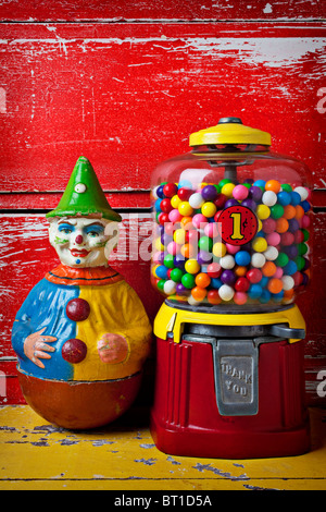 Old clown toy and gum machine - Stock Photo