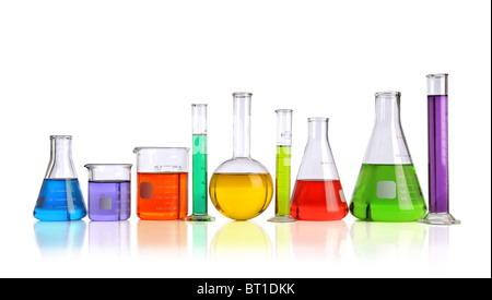 Laboratory glassware with liquids of different colors with reflections on table - Stock Photo