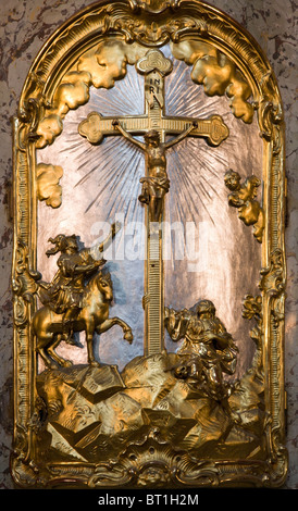cross from altar - Prague - st. Nicholas baroque church - Stock Photo