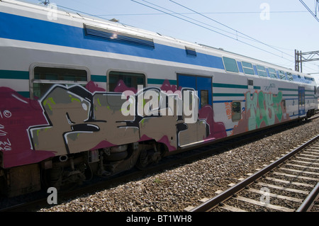 graffiti art artist street tag tags tagging tagged spray paint painted on a train carriage carriages trains covered - Stock Photo
