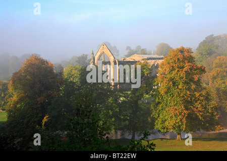 Bolton Priory in Autumn mist, Bolton Abbey, Yorkshire Dales National Park, North Yorkshire, England, UK. - Stock Photo