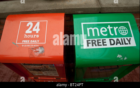 24 hours free daily and metro free daily newspapers boxes sit side by side in Ottawa Sunday September 26, 2010. - Stock Photo