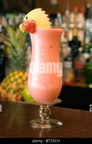 Strawberry Longdrink in a hurricane-glass with decoration of strawberry - Stock Photo