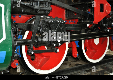 Drive mechanism and red train wheels of an old soviet steam locomotive - Stock Photo