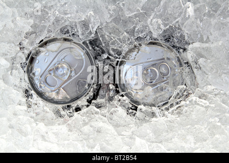 two drink can iced submerged in frost ice closeup - Stock Photo