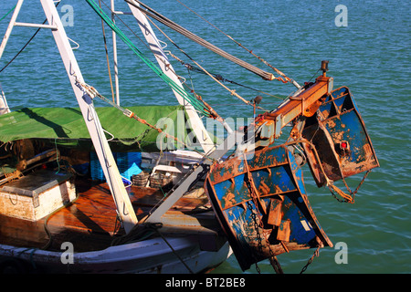Trawler boat tackle plates down rigger destroy the seabed - Stock Photo