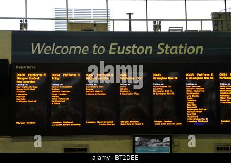 Train departure board at Euston railway station, London, UK. - Stock Photo