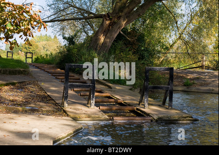 A set of rollers in Mesopotamia to allow Oxford Punters to bring their punts up to the river level on the River - Stock Photo