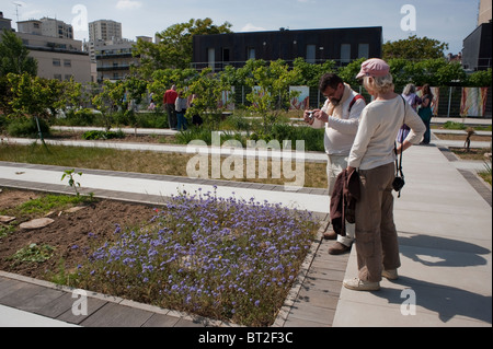 Paris, France, Couple Visiting Community Garden on New Low-income Public Housing Estate Building, Modern Roof - Stock Photo