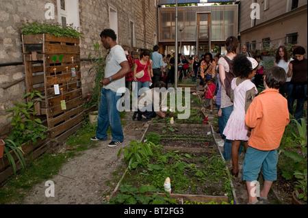 Paris, France, French Families Visiting Backyard Community Garden, Low-income Public Housing Building - Stock Photo
