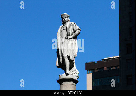 Statue of Christopher Columbus atop a pedestal in Columbus Circle in New York City - Stock Photo