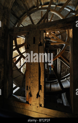 Tread wheel used to haul supplies up at the Mont Saint-Michel / Saint Michael's Mount abbey, Normandy, France - Stock Photo