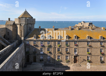 Historic building and view from rampart over Fort National at Saint-Malo, Brittany, France - Stock Photo
