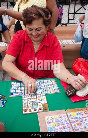 Woman playing bingo campechano during a fair in Campeche, Mexico - Stock Photo