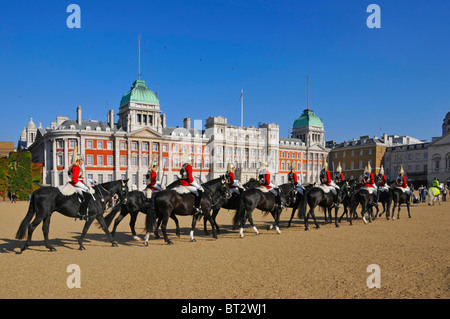 Household Cavalry arriving on Horse Guards Parade for Changing the Guard ceremony - Stock Photo