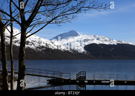 Loch Lomond with a snow capped Ben Lomond in the background - Stock Photo