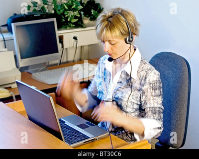 telephone operator in the office - Stock Photo