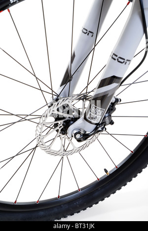 Mountain bike front wheel with hydraulic disc brakes and suspension fork - Stock Photo