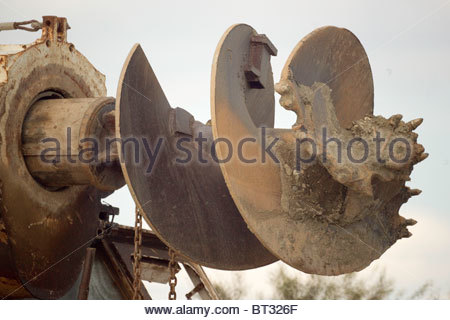 Giant drill fitted to construction vehicle .... used for boring holes for telephone poles and drilling wells - Stock Photo