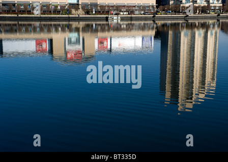 Reflections in water of Lowry Outlet Mall and Sovereign Point Salford Quays Manchester UK - Stock Photo