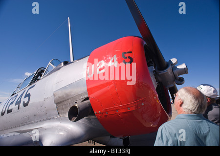 Aviation enthusiasts inspect a North American Aviation T-6 Texan, at the Ruidoso Mountain High Fly In, Ruidoso, - Stock Photo