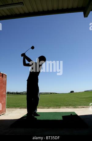 Teenage boy at driving range - Stock Photo