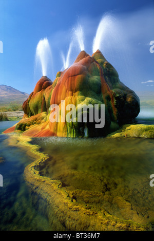 The continuous Fly Geyser in the Black Rock Desert in Nevada - Stock Photo