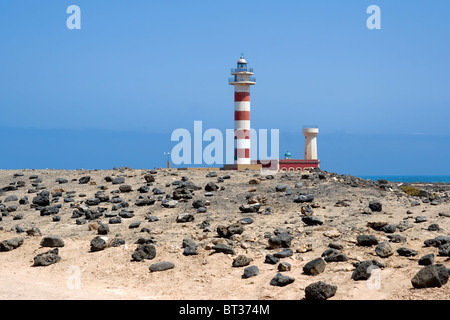 Lighthouse in a white sand beach in Fuerteventura, Canary Islands, Spain - Stock Photo