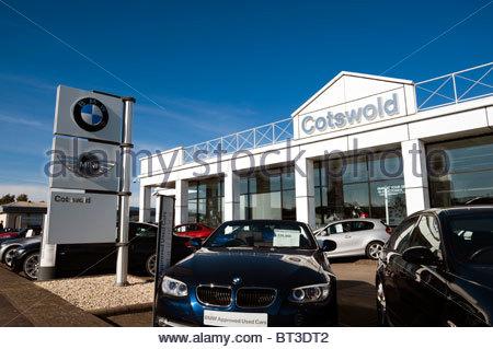 BMW Mini Cotswold car dealership in Cheltenham, UK. Used BMW cars on garage forecourt. - Stock Photo