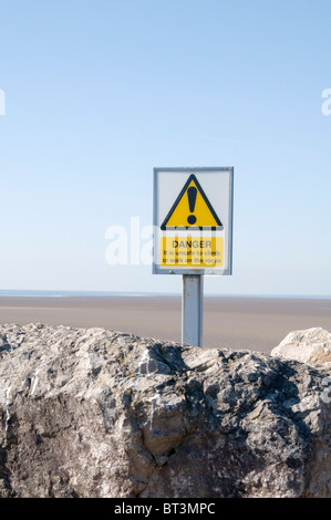 danger sign health and safety warning ! achtung exclamation mark  morecombe beach beaches dangerous sand sands tidal - Stock Photo